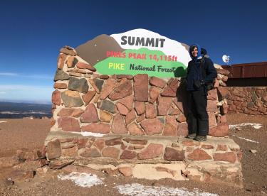 Essay finalist Nicholas at the summit of pikes peak